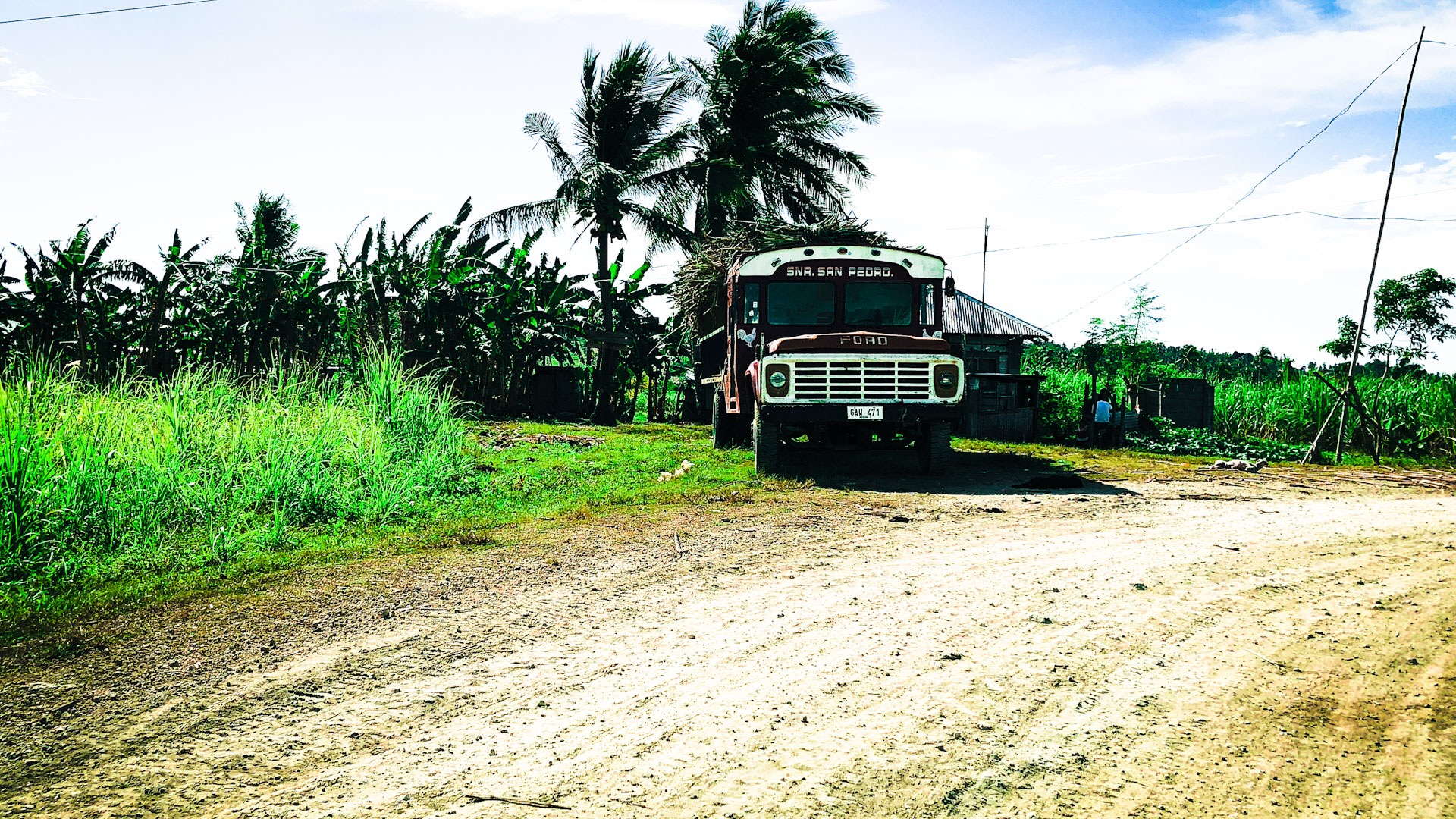 Take a ride with us on the motorbike as we leave the village and venture through the beauty of the sugar cane fields.