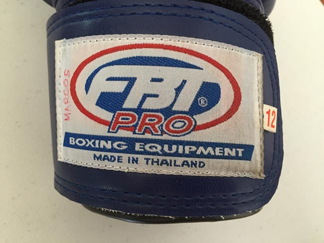 One-Hour Muay Thai Workout Plan for Expats in Thailand - Gloves FBT Pro Boxing Equipment