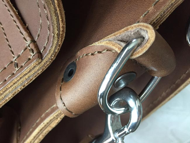 Saddleback Leather Classic Briefcase - Large - Tobacco - The Most Interesting Travel Bag - Closeup of Strap Attached with Rivet