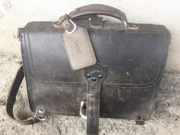 Saddleback Leather Thin Briefcase Travel Photos - Beautiful Scratches on the Front - Carbon Black