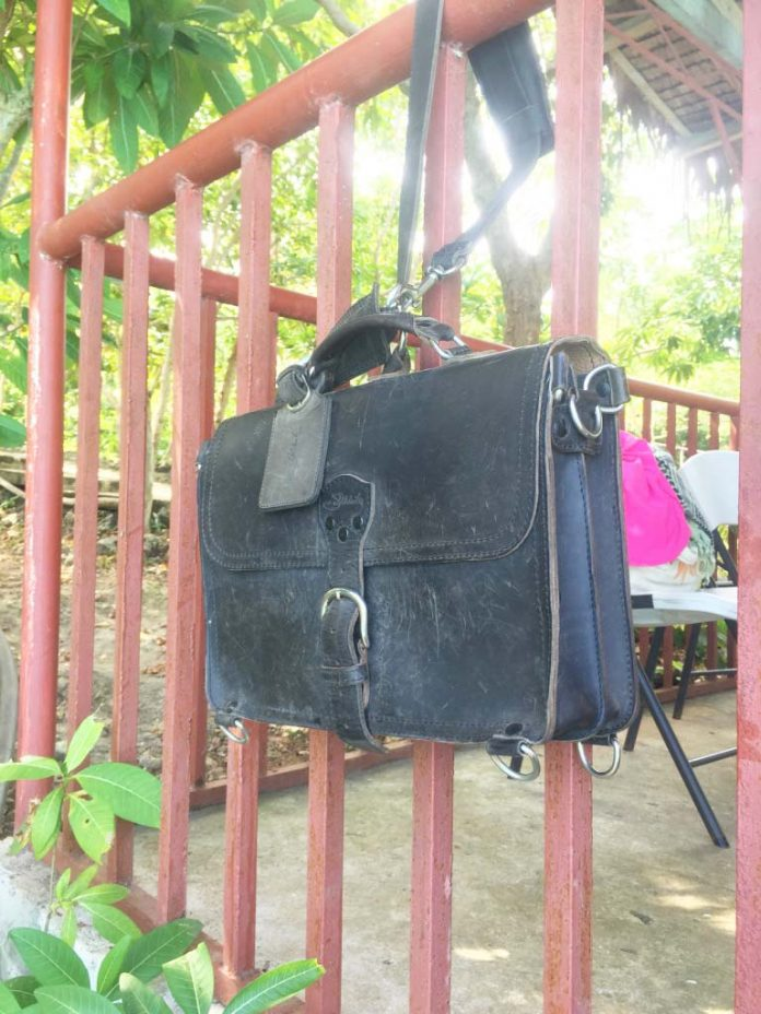 Saddleback Leather Thin Briefcase Travel Photos - Secured with Shoulder Strap